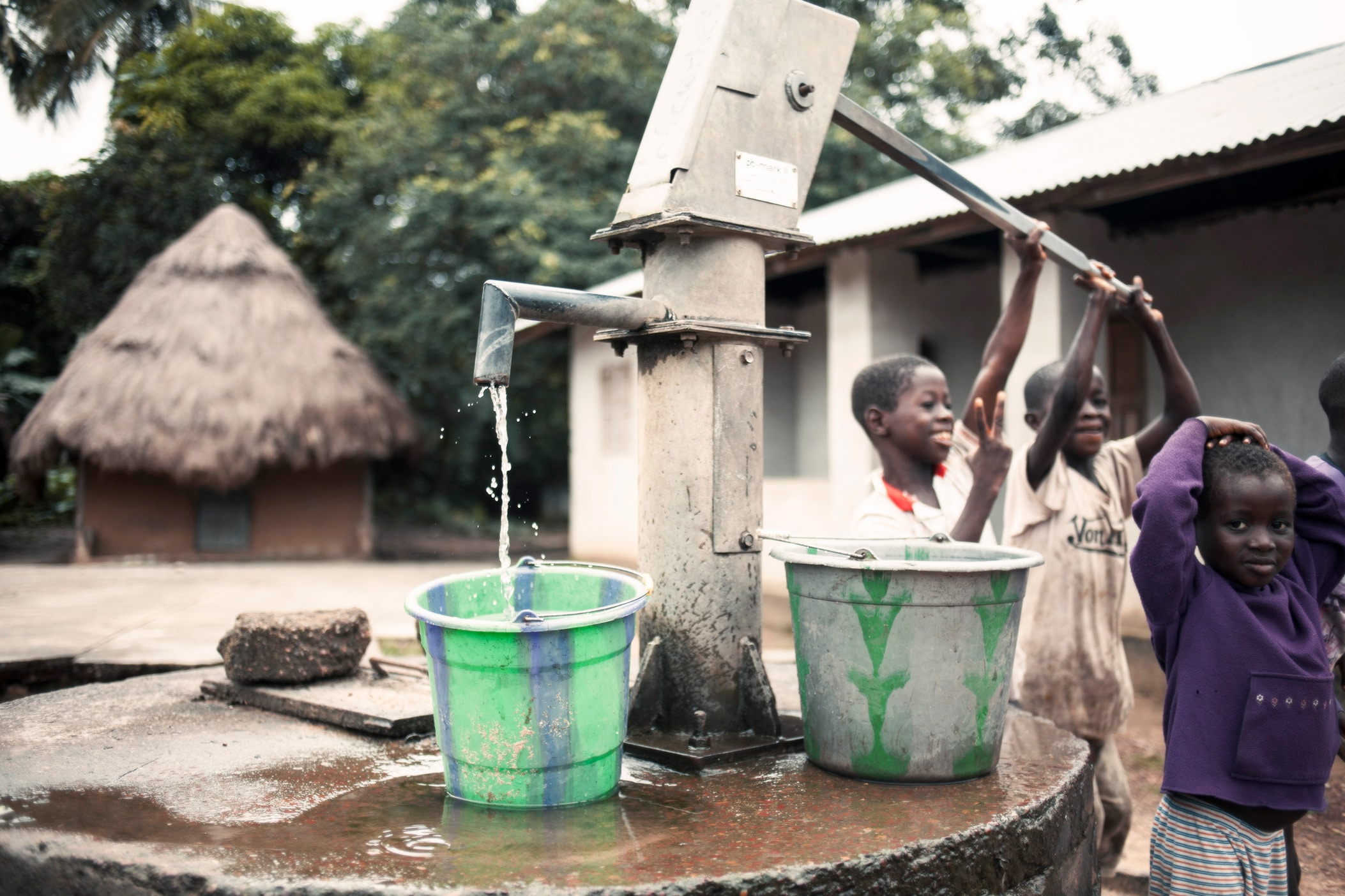 children by water pump